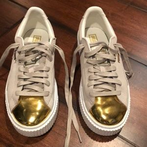 Puma gold toe sneakers. Worn only one time.